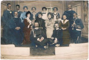 Actors of the amateur performance (Maria Nikolaevna - in a red dress). Odessa, 1903.